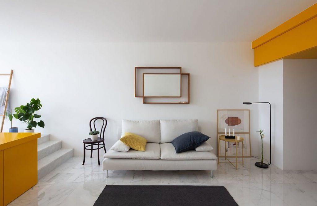 Nội thất phòng khách của căn hộ studio với thiết kế tối giản, hiện đại