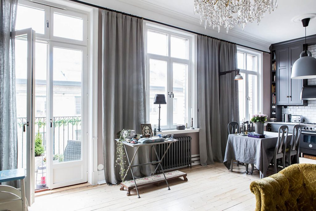 neoclassical apartment space filled with light and wooden floor