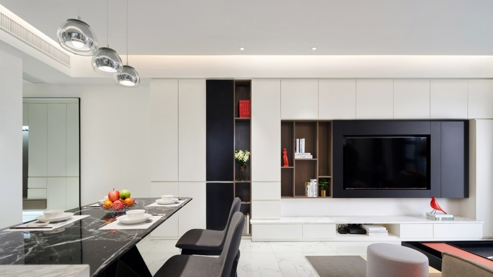 TV cabinets and cupboards decorate the living room using opposite colors white and black