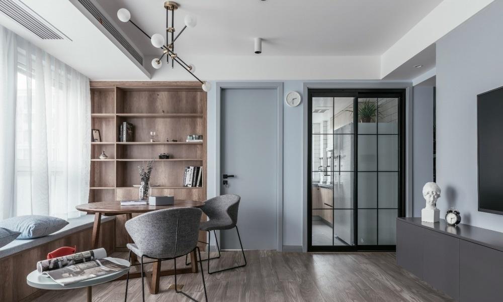 Phòng khách được đặt một kệ tủ và bàn ăn - thiết kế nội thất chung cư nhỏ
