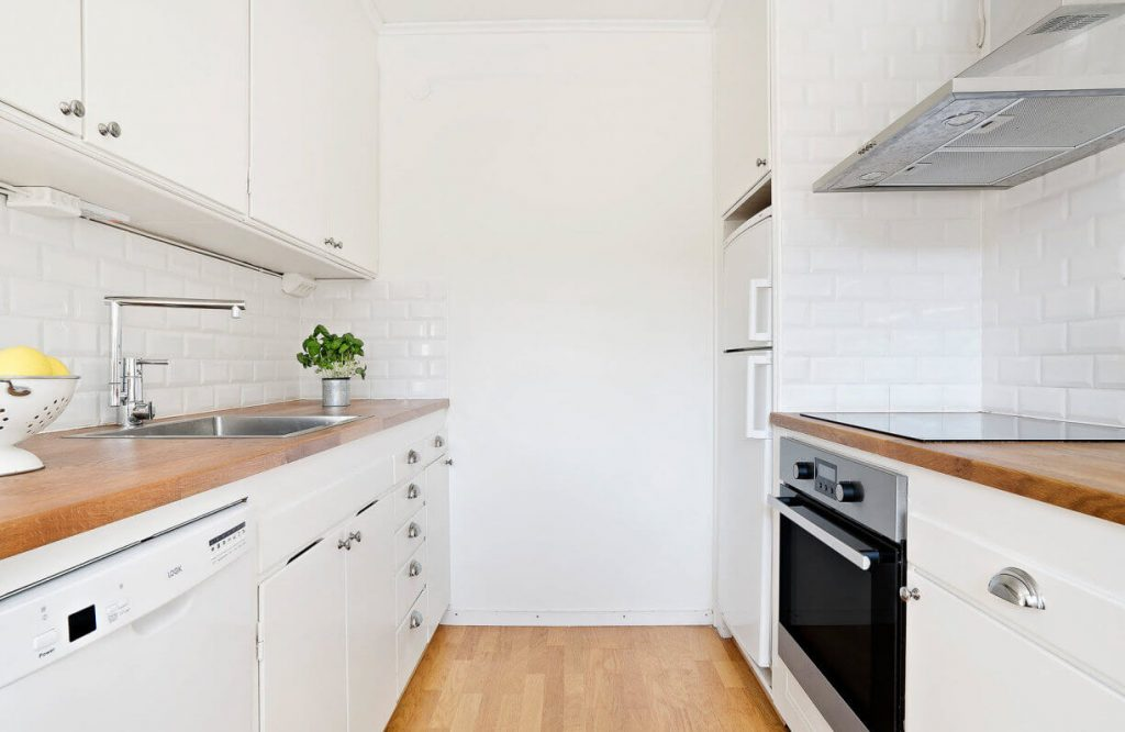 Kitchen appliances such as wooden cabinets, refrigerators, beautiful stainless steel washbasin - one-bedroom apartments