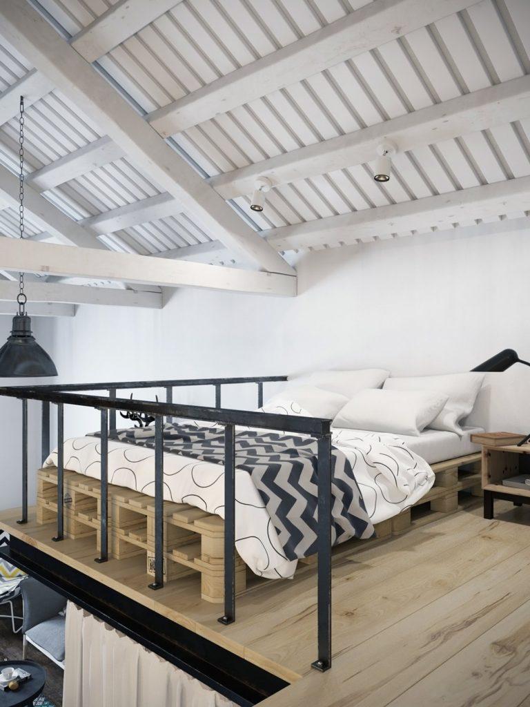căn hộ có gác lửng sử dụng làm phòng ngủ có giường to và bộ ga đệm màu trắng.
