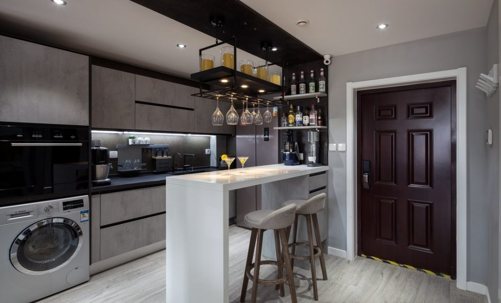 The kitchen bar is designed as a small cafe for apartments