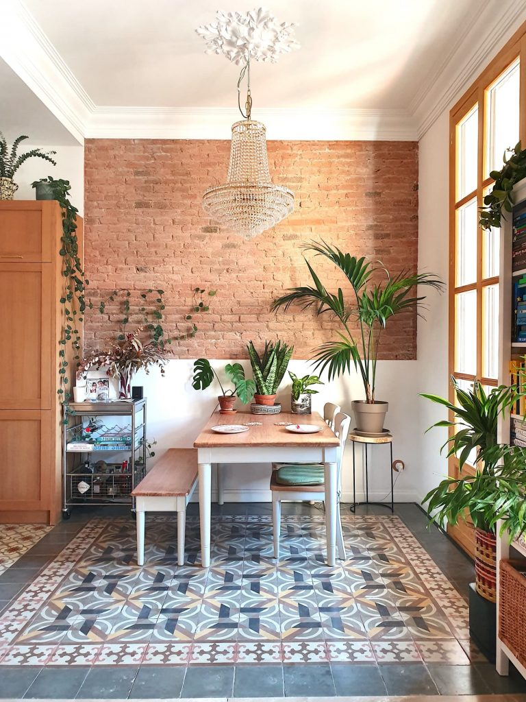 the dining area has a brick wall and the background uses floral and decorative bricks