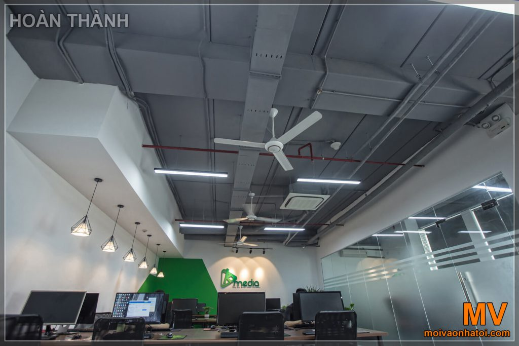 The design of office ceiling in black paint shows the technical pipeline