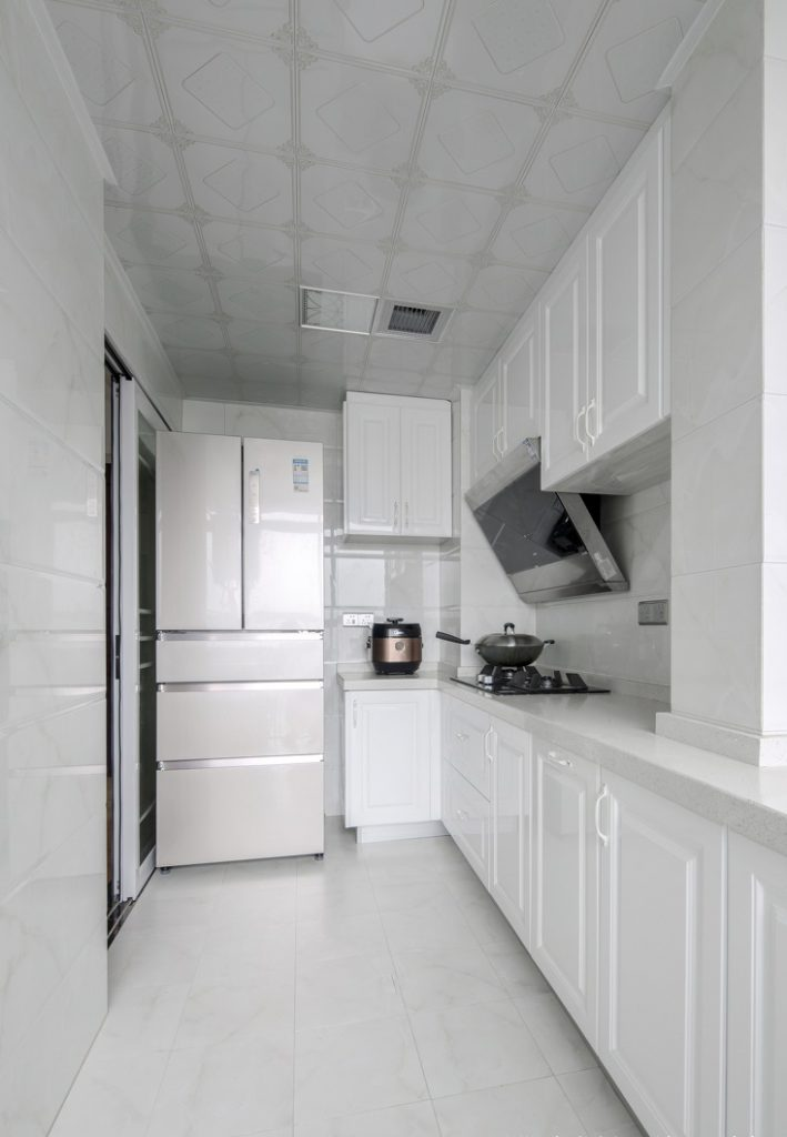 white cardboard kitchen, basic cookware like refrigerators, gas stoves, hoods, kitchen cabinets