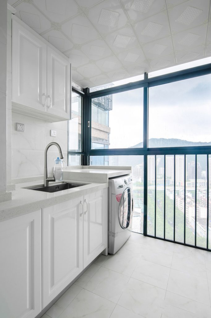 kitchen with balcony and washing machine with sink