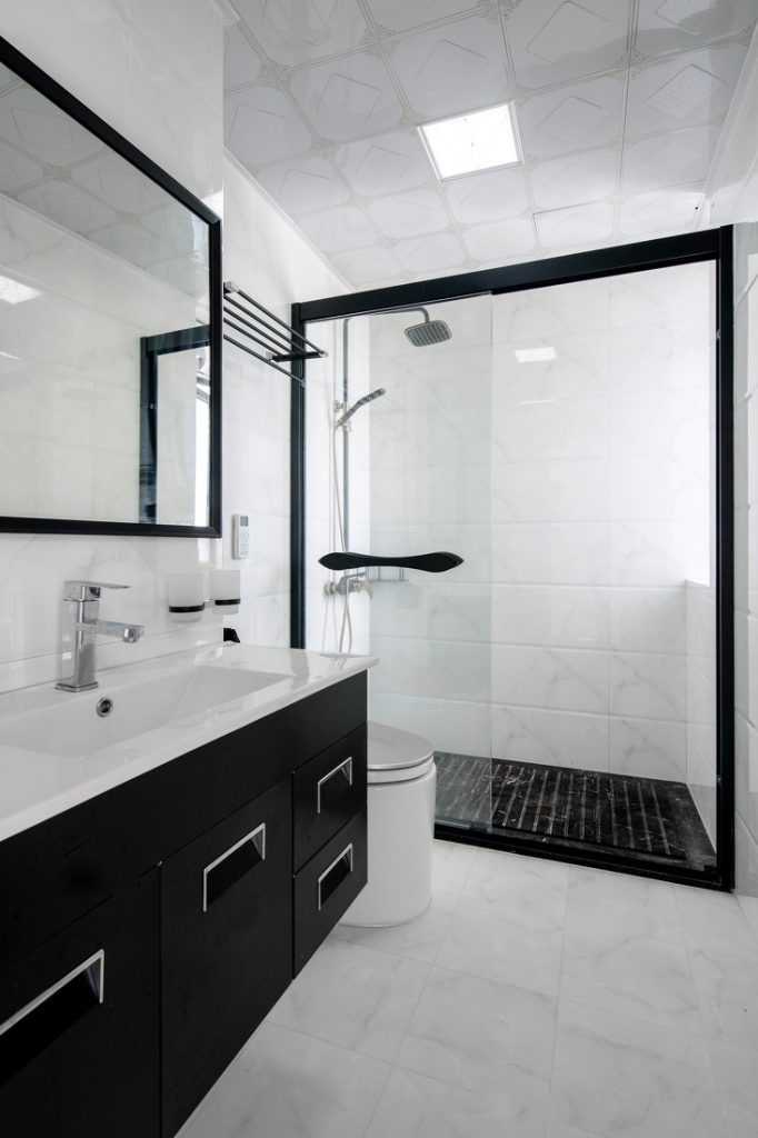 black and white bathrooms are clean, fully sanitary and equipped with glass cabinets and glass shower walls