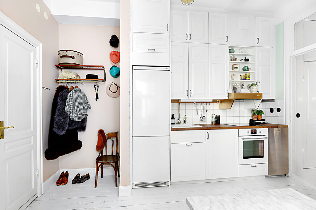 kitchen with industrial wood cabinets, large fridge - small apartment