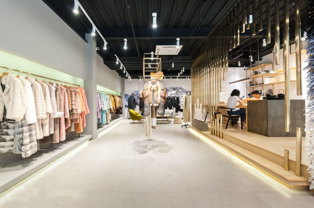 Overview of clothing shop overview with electric lighting system for big light